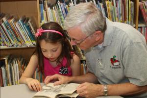 """Mr. Boomsma making discoveries with Kendall Kimball, one of his many young friends at Piscataquis Community Elementary School. (Kendall's chosen career is to be a pop star when she grows up and she's already proving to be a """"media darling."""")"""