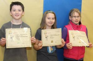Fourth Grade winners Eli Riitano (1st), Meriel Willey (2nd), Summer Nesbit (3rd)