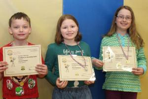 Third Grade winners Zachariah Demmer (1st), Olivia Richardson (2nd), Abrielle Kemp (3rd)